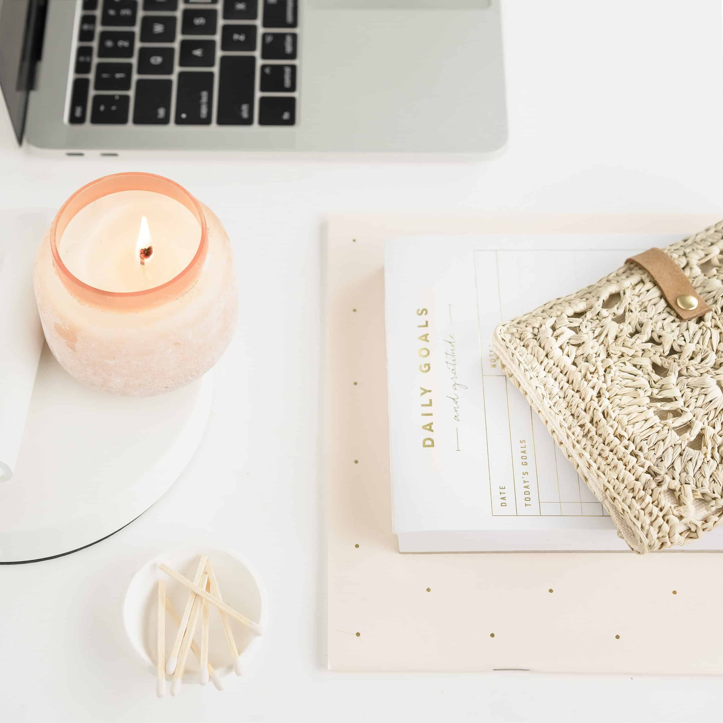 Neutral desktop with candle peaceful, tranquil, journal, goals